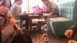 Asians Relaxing in the Restaurant Smoking Hookah