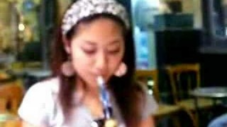 Beautiful Asians Smoking Hookah Outside